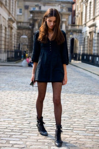 black mini sweater dress with three-quarter sleeves and leather ankle boots
