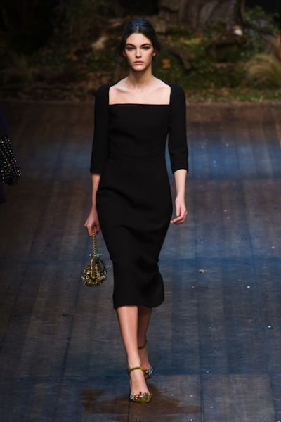 black bodycon dress with three-quarter sleeves and a square neckline