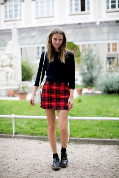 black three-quarter sleeve sweater with red checked mini skirt