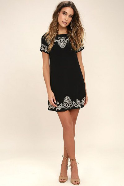 black embroidered short-sleeved mini dress with tribal pattern
