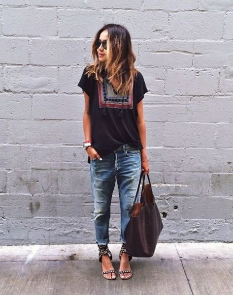 black t-shirt with tribal print with badly torn and washed boyfriend jeans