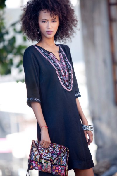 black tunic dress with tribal print and matching clutch