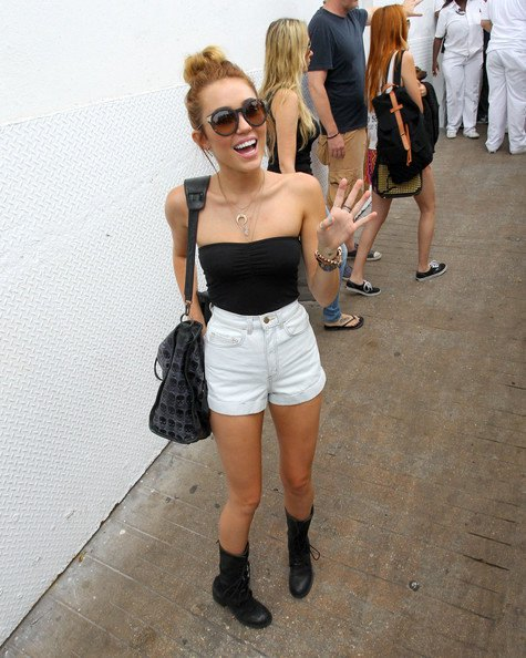 black tube top with white, high-waisted mini-shorts