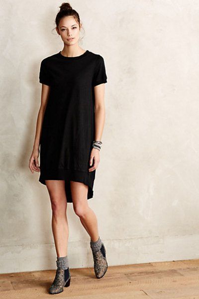 black tunic dress with gray socks and boots