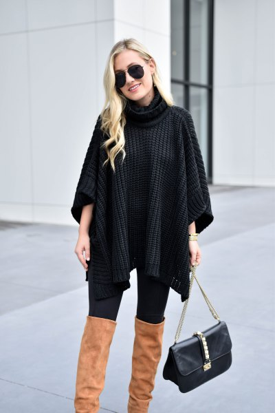 black turtleneck sweater with cable pattern and camel overknee boots