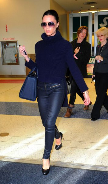black knitted sweater with turtleneck and waxed skinny jeans