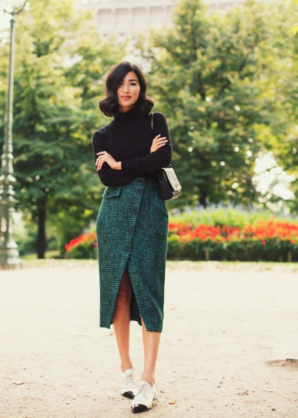 black turtleneck with a gray tweed tulip skirt