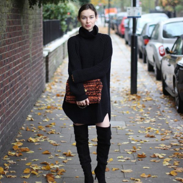 black turtleneck sweater dress with over-the-knee boots made of suede