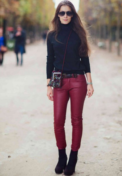 black turtleneck with red, narrow leather pants
