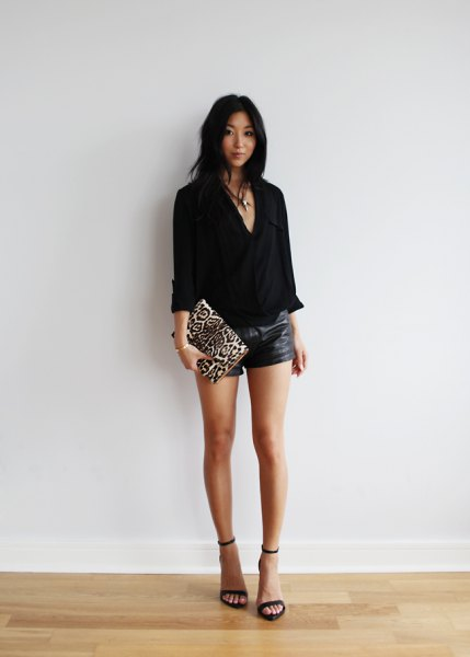 black leather shorts with V-neck and blouse