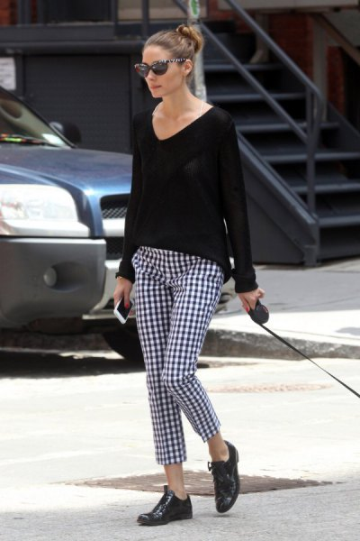 black comfortable sweater with V-neck and checked pants