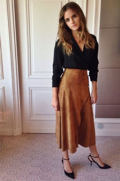 black long-sleeved blouse with V-neck and flared maxi skirt made of brown suede