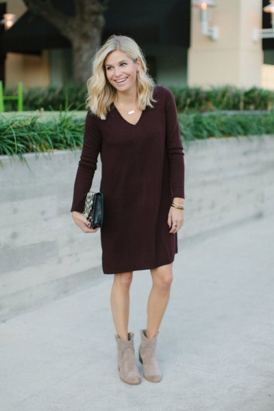 black knee-length shift sweater with V-neck and gray boots