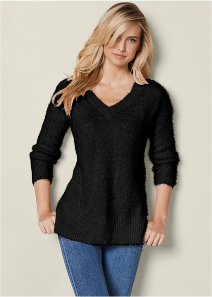 black slim fit knitted sweater with V-neckline and blue skinny jeans