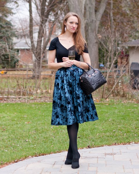 black t-shirt with V-neck and purple printed midi taffeta flared skirt