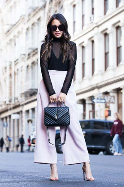 black waistcoat above white pants with wide legs