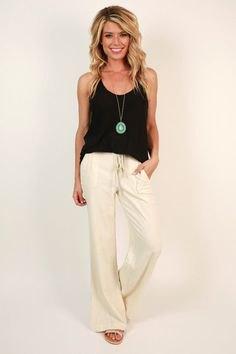 black vest top with white flared pants