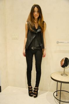 black vest with chiffon blouse and coated skinny jeans