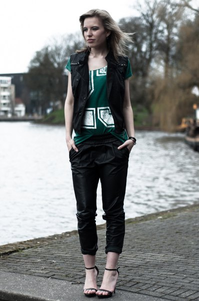 black vest with gray printed t-shirt and leather pants