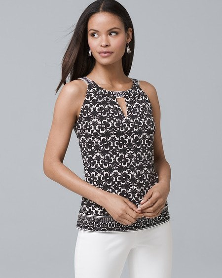 black white and silver keyhole tank top with white skinny jeans