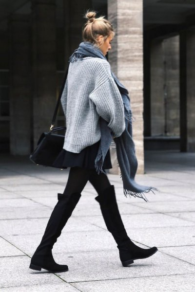 black knee-high boots with wide calves, gray knitted sweater