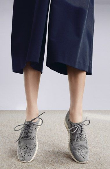 black wide-leg pants and gray wingtip suede shoes