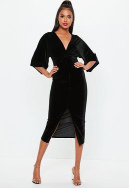 black, wide dress with three-quarter sleeves and V-neck