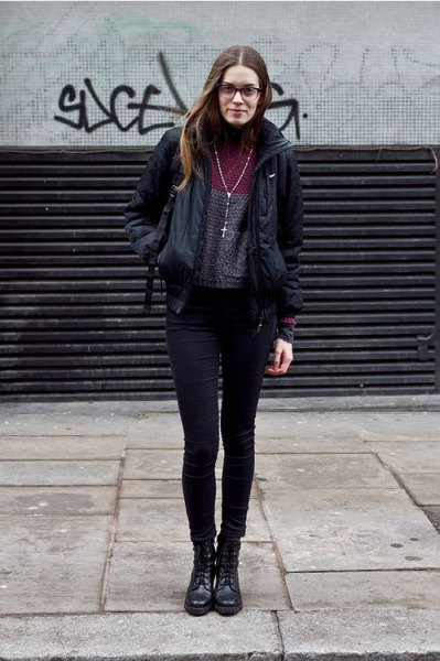 black windbreaker with gray mock-neck sweater and skinny jeans