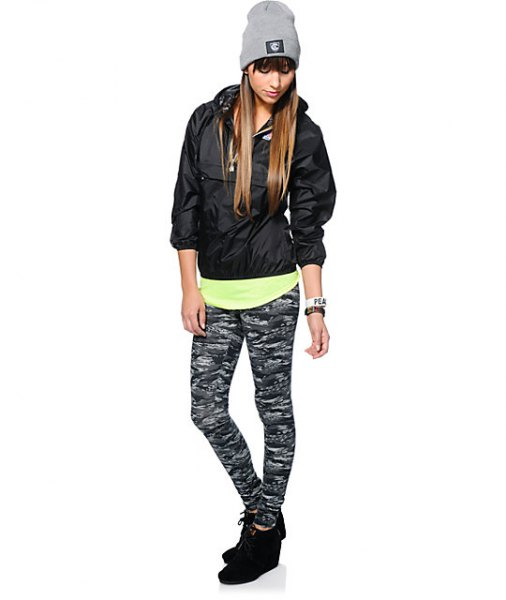 black windbreaker with light yellow T-shirt and camo drainpipe pants