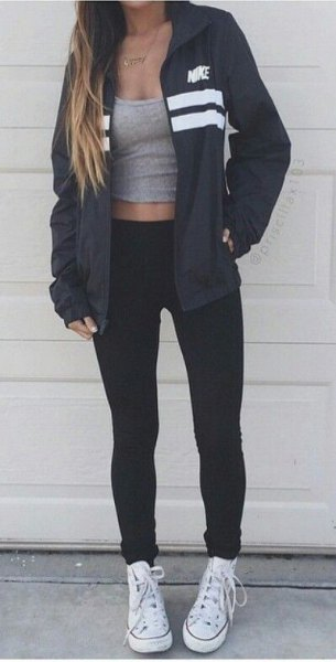 black windebreaker with gray tank top with scoop neck and white canvas sneakers