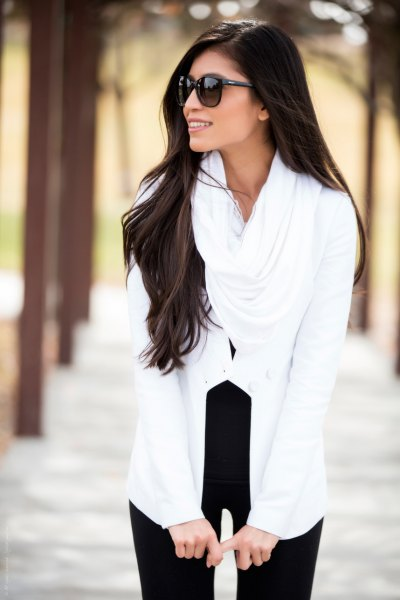 Black with a white infinity scarf and black high-waisted skinny jeans