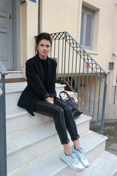 black wool blazer with leather pants and silver metallic sneakers