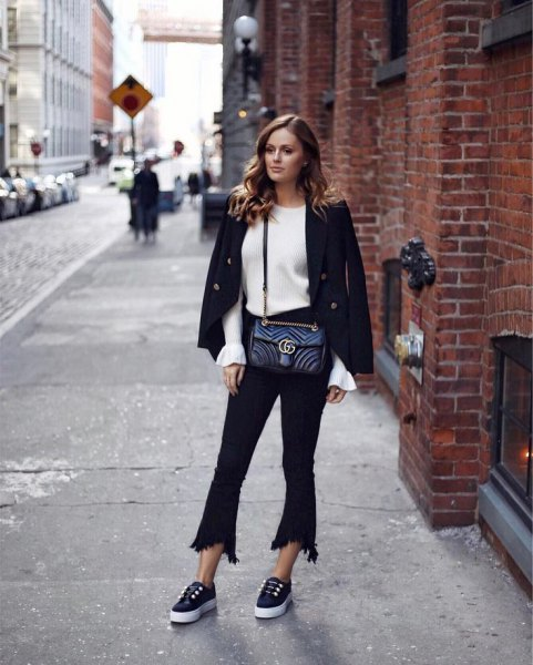 black wool blazer with white knitted sweater and flared short jeans