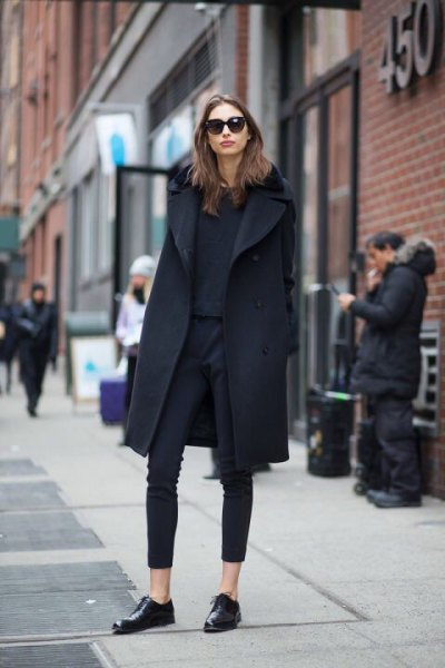 black wool coat with ankle-less skinny jeans and leather shoes