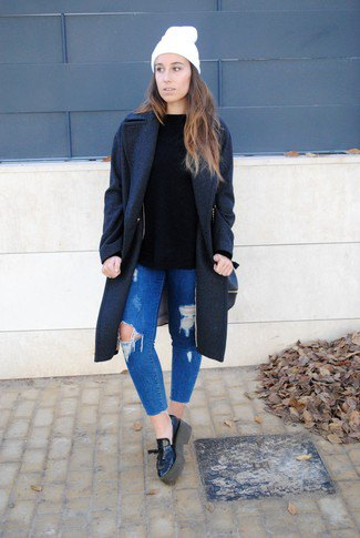 black wool coat with blue ribbed slim fit jeans and leather loafers