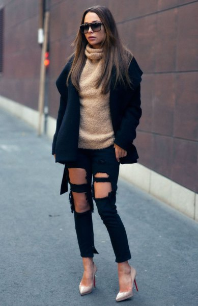 black wool coat with a fluffy turtleneck and heavily torn jeans