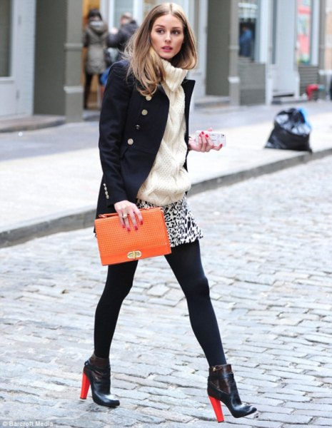 black wool coat with mini skirt with leopard print and brown leather handbag