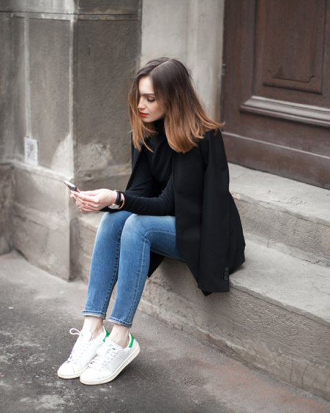 black wool coat with mock neck sweater and ankle mom jeans