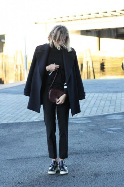 black wool coat with imitation sweater and leather loafers