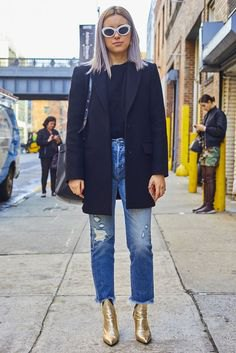 black wool coat with ripped ankle jeans