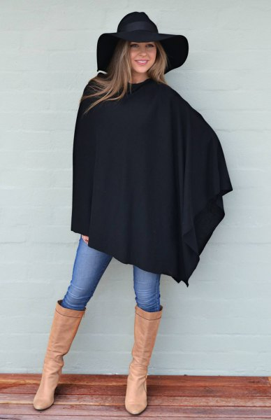 black wool poncho floppy hat leather boots