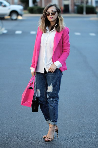 Blazer with a white chiffon shirt and ripped dark blue straight leg jeans