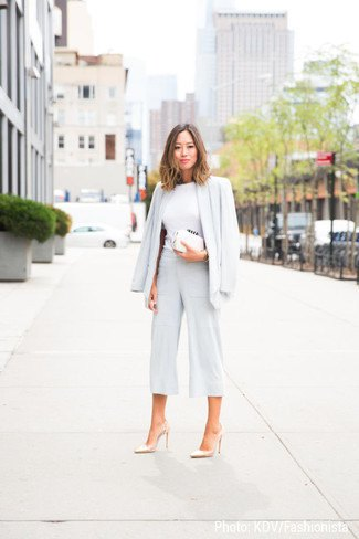 Blazer with white mock-neck sweater and wide-cut trousers