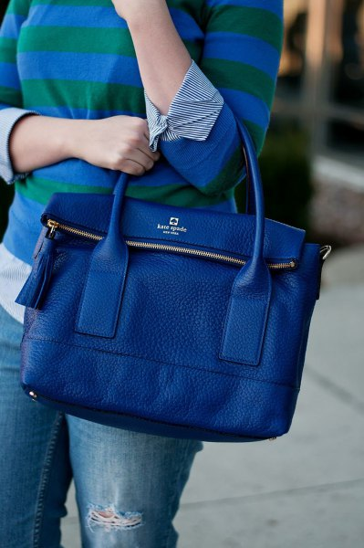 blue-black striped long-sleeved T-shirt with jeans and leather handbag