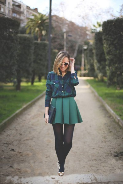blue-green checked shirt with a mini gray pleated skirt