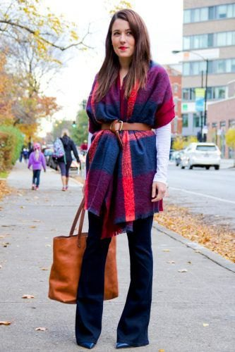 blue and orange pashmina blanket scarf with belt, black blouse and flared jeans