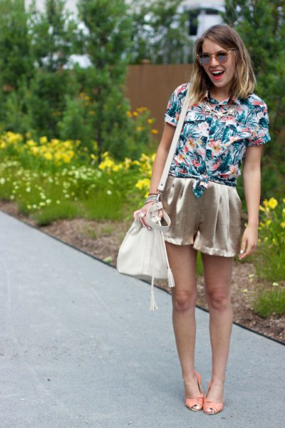 blue and white shirt with floral pattern and rose gold mini silk shorts