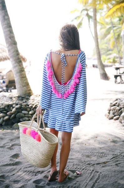 blue and white mini dress with low back and straw sack