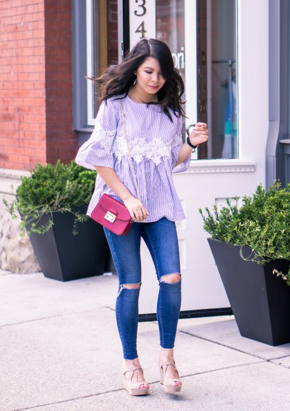 blue and white striped bell sleeve blouse with ripped jeans