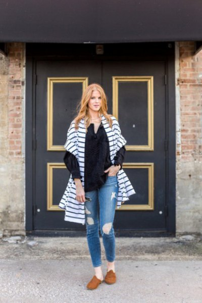 blue and white striped oversized cardigan with ripped jeans and brown suede shoes